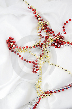 Beads On White Silk Stock Images - Image: 6648634