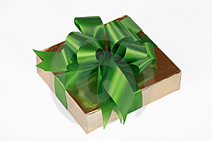 Gold Present Wrapped With Green Ribbons Royalty Free Stock Photography - Image: 6652967