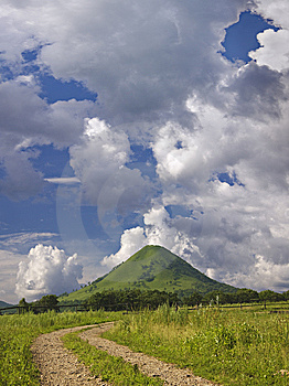 Lonely Mountain Under Quaint Clouds In Sunny Day Royalty Free Stock Photo - Image: 6654685