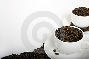 Two Coffee Cups with Coffee Beans