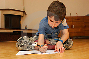 Little boy learning to write Stock Images