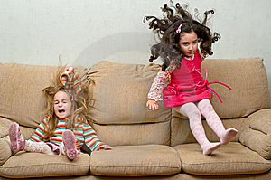 Two Little Girls Jumping On Sofa Royalty Free Stock Images - Image: 6679979