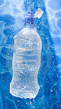 Water bottle in a water splash