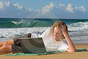 Blonde Businesswoman Lies With Notebook On Beach Stock Photos - Image: 6695743