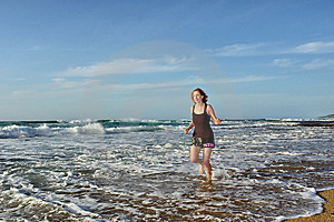 Smiling Woman Jogs In Water On Beach Royalty Free Stock Images - Image: 6695759