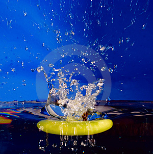 Splash background with sinking apple Stock Photos