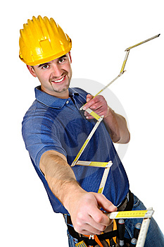 Isolated yourg smailing  standing worker Royalty Free Stock Image