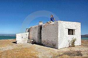 Young Man On Roof Of Abandoned House Looks At Sea Royalty Free Stock Photos - Image: 6711658