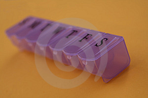 Purple Pill Container On Gold Table Royalty Free Stock Photo - Image: 6722195
