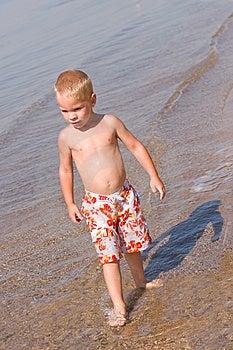 Boy Walking At The Beach Royalty Free Stock Photo - Image: 6753265