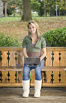 Teenage Girl Using Her Laptop In The Park Royalty Free Stock Photos - Image: 6758988