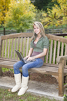 Teenage Girl Using Her Laptop In The Park Stock Images - Image: 6759004
