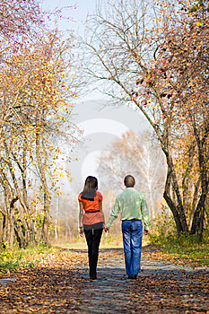 Young Couple Walking In The Park Royalty Free Stock Photo - Image: 6770305