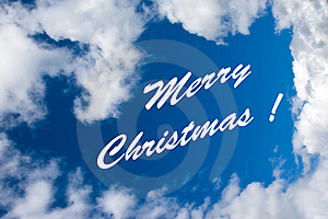 Merry Christmas Inscription At The Cloudy Sky Royalty Free Stock Image - Image: 6772726