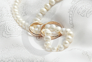 Pearls And Wedding Bangs On A Fabric. Stock Images - Image: 6785984