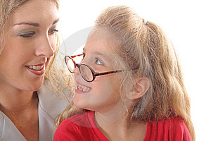 Little Girl Looking At Mom With Glasses Smiling Stock Images - Image: 6787864