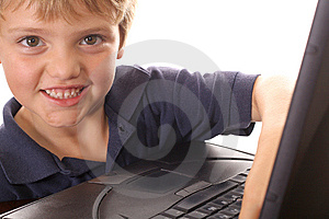 Happy Little Boy Checking Emails On Computer Royalty Free Stock Photo - Image: 6787915
