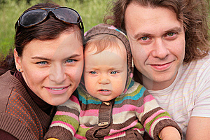 Parents With Child On Nature Stock Images - Image: 6791694