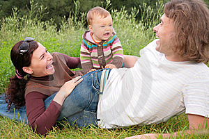 Parents With Baby Lies On Nature Stock Photos - Image: 6791963