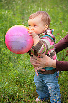 Mother Hold Baby With Ball Royalty Free Stock Image - Image: 6792096