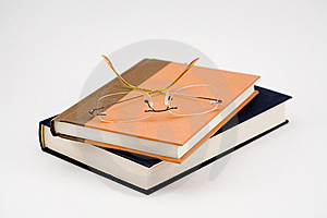 Two Closed Books And A Pair Of Glasses Royalty Free Stock Photo - Image: 6792135