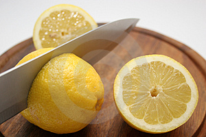 Lemon With Batten And Cutter Royalty Free Stock Image - Image: 689646