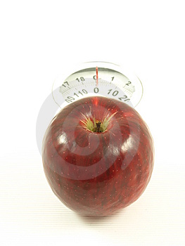 Apple On Scales, Isolated Royalty Free Stock Image - Image: 6809866