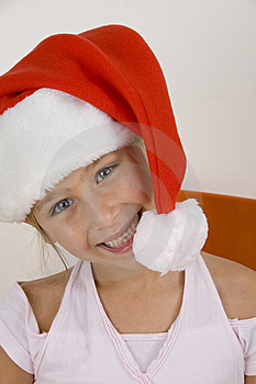 Smiling Little Girl Wearing Christmas Hat Stock Images - Image: 6810694
