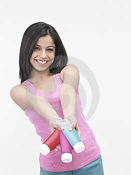 Asian Female With Cream Tubes Stock Photography - Image: 6811522