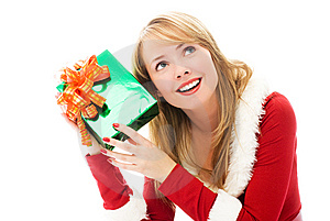 Pretty Girl Shaking A Christmas Present Stock Photography - Image: 6817802