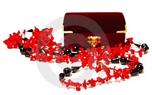 Coral Red And Black Beads (necklace) And Chest. Stock Images - Image: 6820814