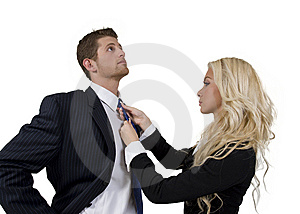 Lady Knotting Tie Of Man Stock Photo - Image: 6829420