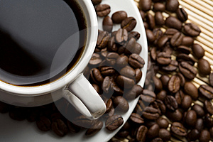 Cup of coffee and coffee beans Stock Images