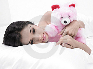 Woman In Bed With Teddy Bear Stock Image - Image: 6831481