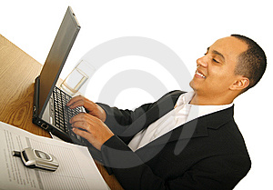 Happy Business Man Typing Royalty Free Stock Images