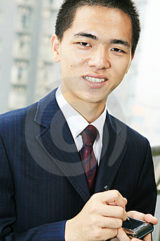 Young Business Man Holding Mobile Phone Stock Image - Image: 6840771