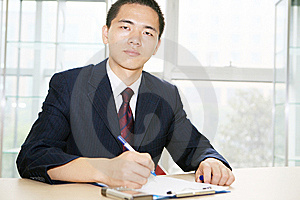 Young Asian Working In Office Royalty Free Stock Image - Image: 6844426