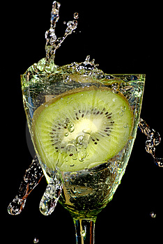 Kiwi In Sparks Of Water Stock Images - Image: 6863474