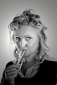 Curly Blonde Pearls In Mouth BW Light Stock Photo - Image: 6864940