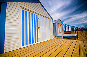 Colourful Beach Huts With Dramatic Sky Royalty Free Stock Photography - Image: 6870557
