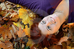 Girl In Leaves Royalty Free Stock Photography - Image: 6877057