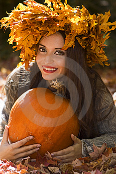 Girl With A Pumpkin Royalty Free Stock Photography - Image: 6880557