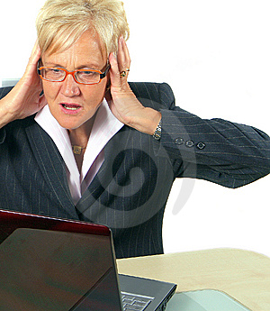 Woman In Shock In Front Of Her Laptop Royalty Free Stock Photo - Image: 6890475