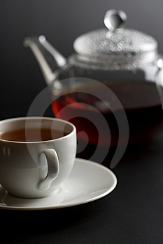 Cup of tea and tea pot Stock Images