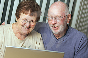 Senior Adults on Laptop Computer Stock Photo