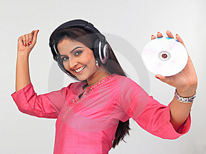 Asian Woman Enjoying Music Stock Photo - Image: 6911240