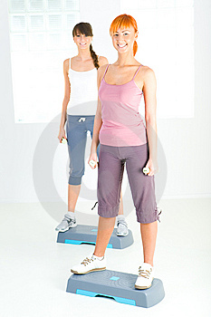 Young women doing fitness exercise Stock Photography