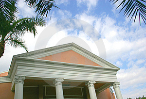 Four Columns Against Cloudy Sky Stock Photo