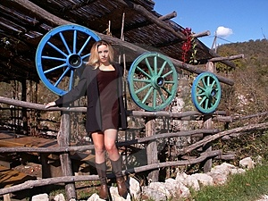Girl And Three Colored Wheels Stock Images