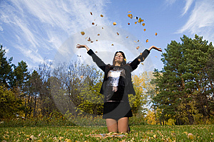 Young Woman Throw Autumnal Leaves Royalty Free Stock Photo - Image: 7008675